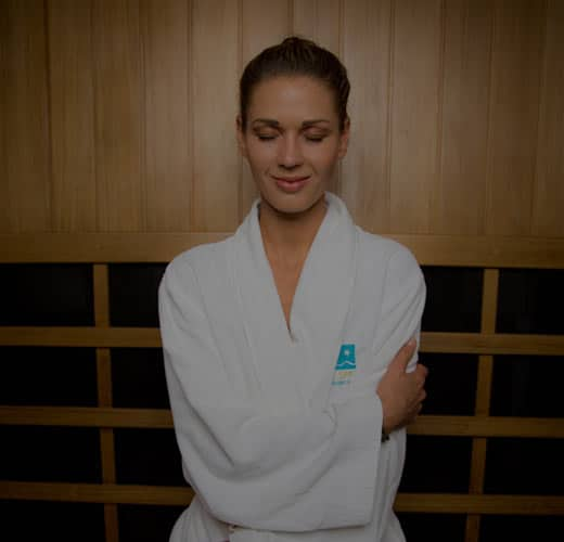woman smiling in sauna