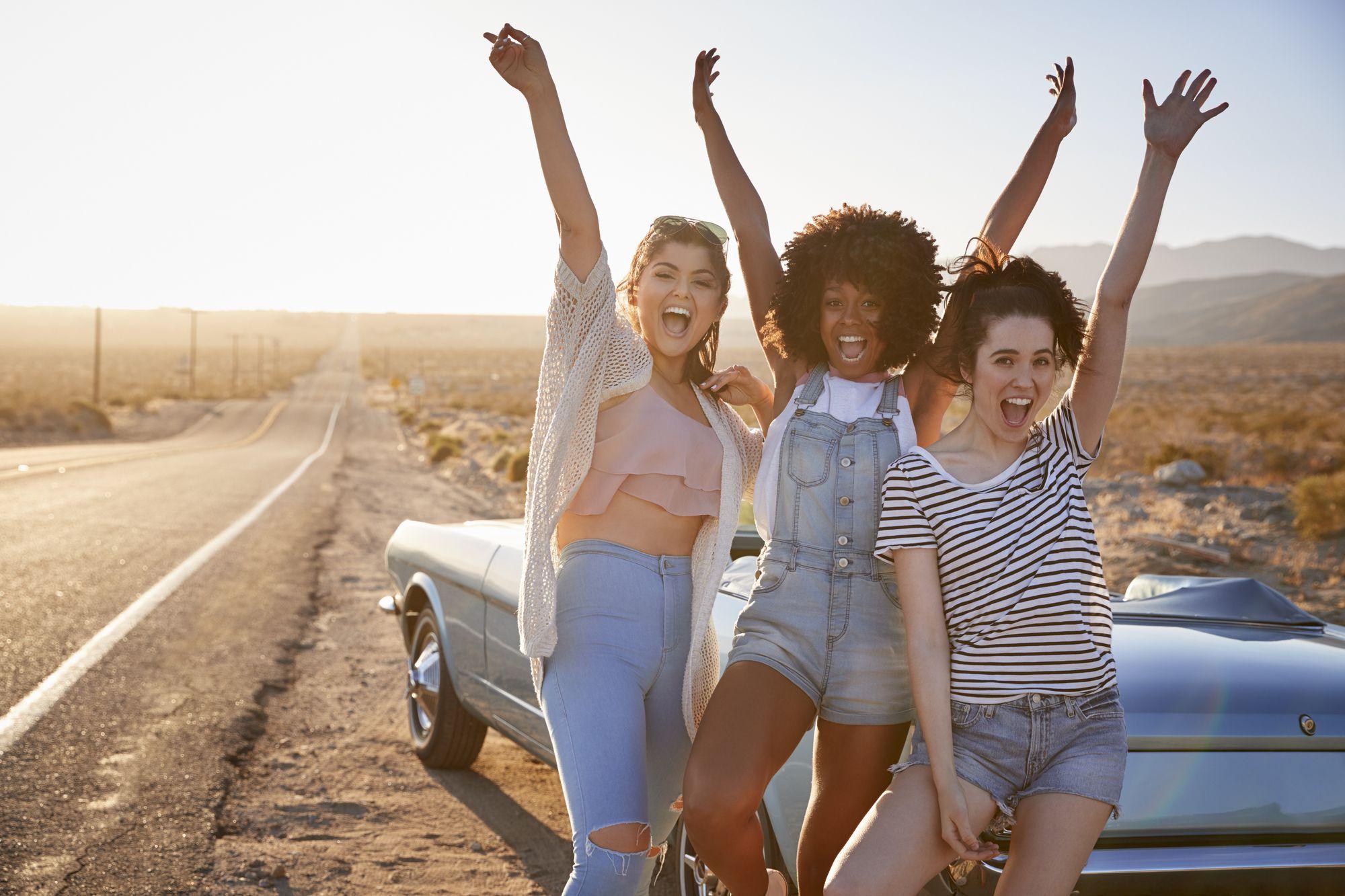 Portrait Of Female Friends Enjoying Road Trip